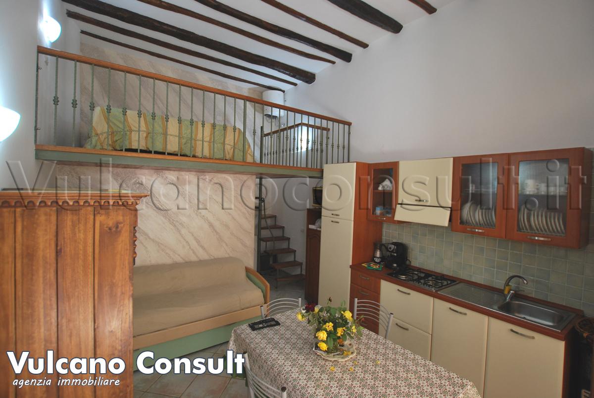 Camera con cucina